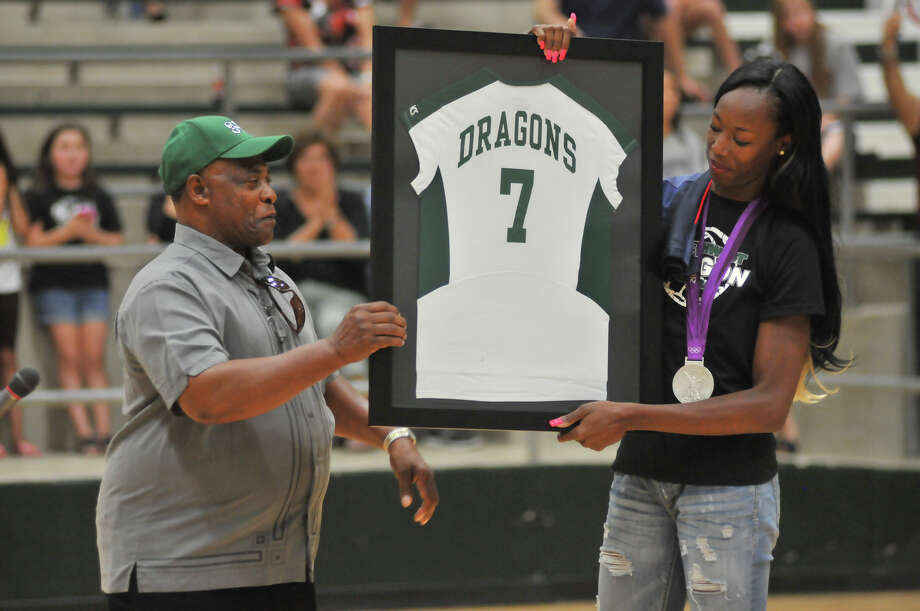 Olympic volleyball silver medalist and Southwest graduate Destinee Hooker's jersey number was retired from the school's volleyball team during a ceremony at the school on Tuesday, Sept. 4, 2012. Here's a look back at her high school, college and professional careers.Hooker accepts her framed jersey from retired track coach Joe Marsh during the retirement ceremony. Photo: ROBIN JERSTAD, For The Express-News