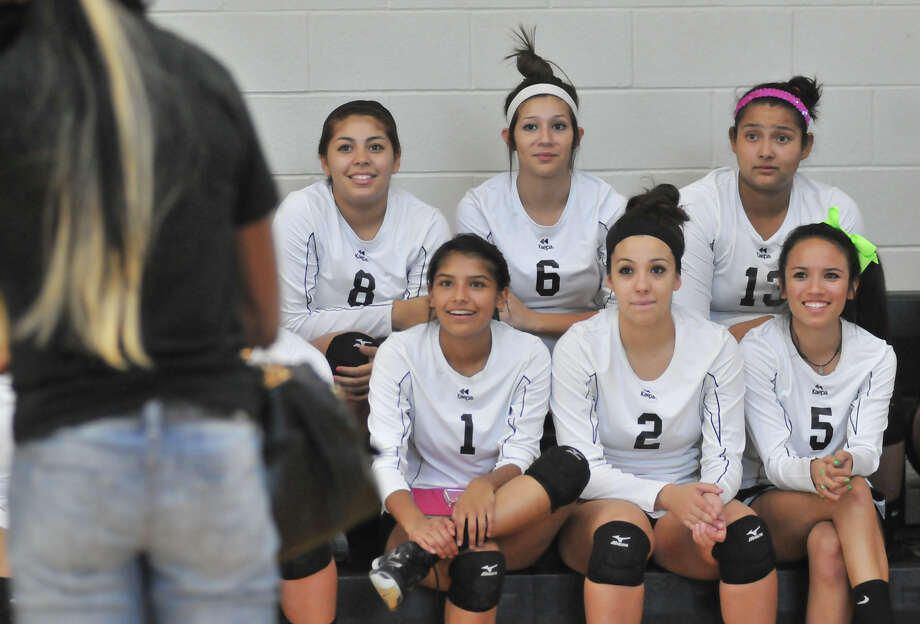 Southwest High School volleyball players Kassandra Cruz, 8; Lindsey Calderon, 6; Kamerie Vidales, 13; Jackie Ontiveros, 1; Melissa Garza, 2; and Brittany Martinez, 5; listen to Southwest graduate and Olympic volleyball silver medalist Destinee Hooker. Hooker was at the school for a ceremony to retire her volleyball jersey Tuesday, Sept. 4, 2012. Photo: ROBIN JERSTAD, For The Express-News