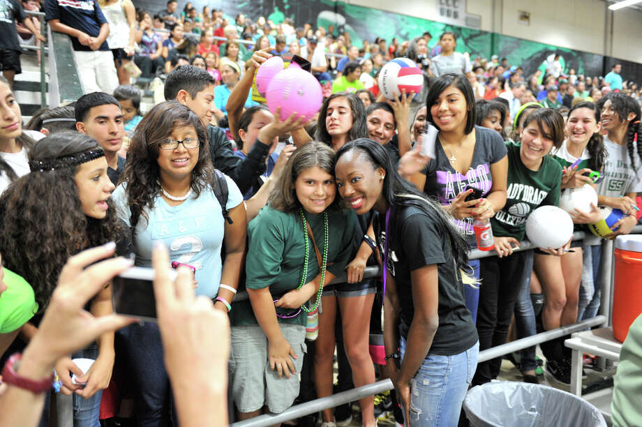 Fans crowd around Southwest graduate and Olympic volleyball silver medalist Destinee Hooker following a ceremony to retire her jersey Tuesday evening, Sept. 4, 2012. Photo: ROBIN JERSTAD, For The Express-News