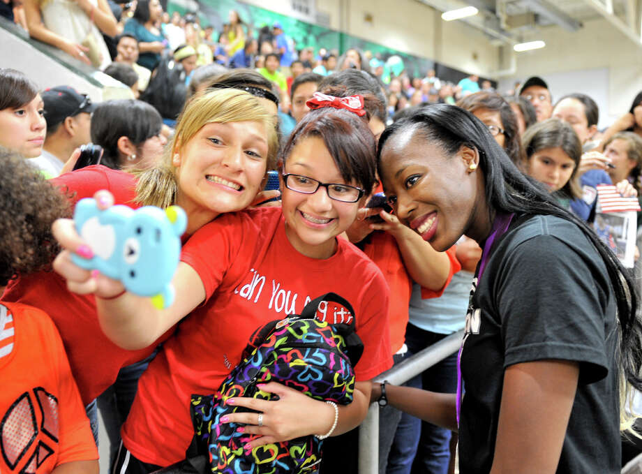 Olympic volleyball silver medalist and Southwest graduate Destinee Hooker (right) takes pictures with Jessica Morales (left) and Gabriella Valdez after the school retired her volleyball jersey during a ceremony Tuesday evening, Sept. 4, 2012. Photo: ROBIN JERSTAD, For The Express-News