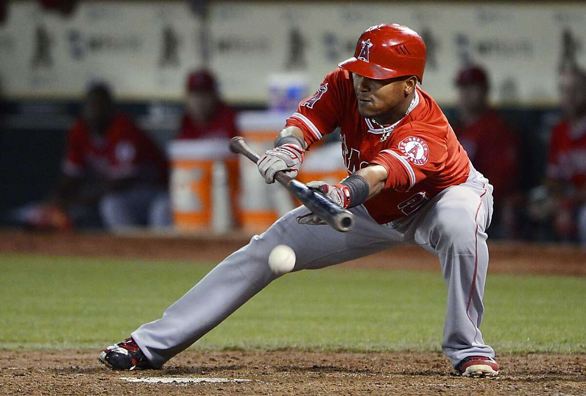 OAKLAND, CA - SEPTEMBER 04: Erick Aybar #2 of the Los Angeles Angels of Anaheim lays down a sacrifice bunt moving the runners over in the six inning against the Oakland Athletics at O.co Coliseum on September 4, 2012 in Oakland, California. (Photo by Thearon W. Henderson/Getty Images)