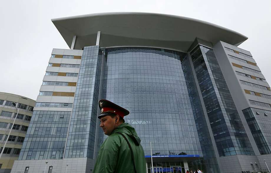 A police officer stands guard outside the media center of the Asia-Pacific Economic Cooperation summit at the Russian far eastern port of Vladivostok Tuesday, Sept 4, 2012. The APEC summit will be held from Sept. 5 to 9. (AP Photo/Vincent Yu) Photo: Vincent Yu, Associated Press