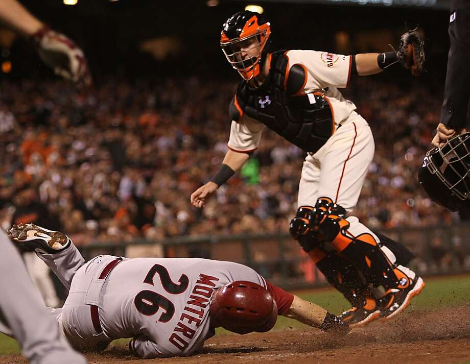 Diamondbacks #26 Miguel Montero slides home with Giants #28 Buster Posey covering during the second inning at AT&T park in San Francisco, Calif., on Monday, September 4, 2012. Photo: Liz Hafalia, The Chronicle