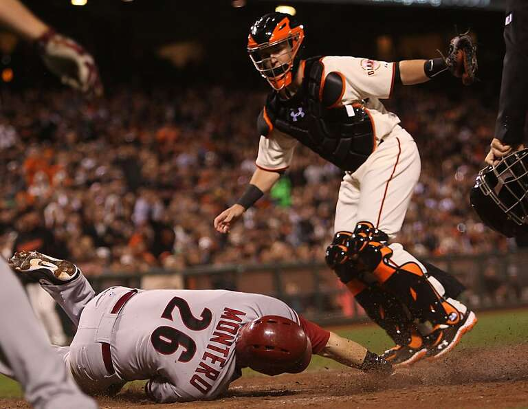 Diamondbacks #26 Miguel Montero slides home with Giants #28 Buster Posey covering during the seco