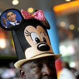 Edgar Baker Phillips, a delegate from the U.S. Virgin Islands, wears a Minnie Mouse hat with a photograph of Barack Obama at the Democratic National Convention (DNC) in Charlotte, North Carolina, U.S., on Tuesday, Sept. 4, 2012. San Antonio Mayor Julian Castro, a Stanford University and Harvard Law School graduate, has the role of first Hispanic keynote speaker at the Democratic National Convention. Photographer: Daniel Acker/Bloomberg *** Local Caption *** Edgar Baker Phillips