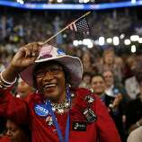 Delegate Gloria Goodwin waves a U.S. flag at the Democratic National Convention (DNC) in Charlotte, North Carolina, U.S., on Tuesday, Sept. 4, 2012. San Antonio Mayor Julian Castro, a Stanford University and Harvard Law School graduate, has the role of first Hispanic keynote speaker at the Democratic National Convention. Photographer: Victor J. Blue/Bloomberg *** Local Caption *** Gloria Goodwin