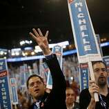 A delegate gestures while cheering at the Democratic National Convention (DNC) in Charlotte, North Carolina, U.S., on Tuesday, Sept. 4, 2012. San Antonio Mayor Julian Castro, a Stanford University and Harvard Law School graduate, has the role of first Hispanic keynote speaker at the Democratic National Convention. Photographer: Victor J. Blue/Bloomberg