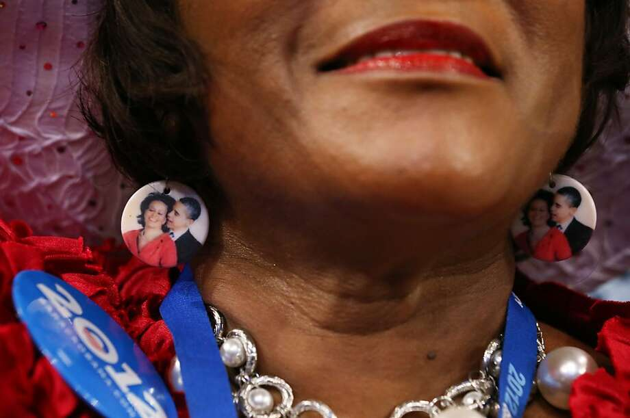 CHARLOTTE, NC - SEPTEMBER 04:  Delegate Gloria Goodwin wears earings depicting Democratic presidential candidate, U.S. President Barack Obama and First lady Michelle Obama as she watches the program during day one of the Democratic National Convention at Time Warner Cable Arena on September 4, 2012 in Charlotte, North Carolina. The DNC that will run through September 7, will nominate U.S. President Barack Obama as the Democratic presidential candidate. Photo: Justin Sullivan, Getty Images