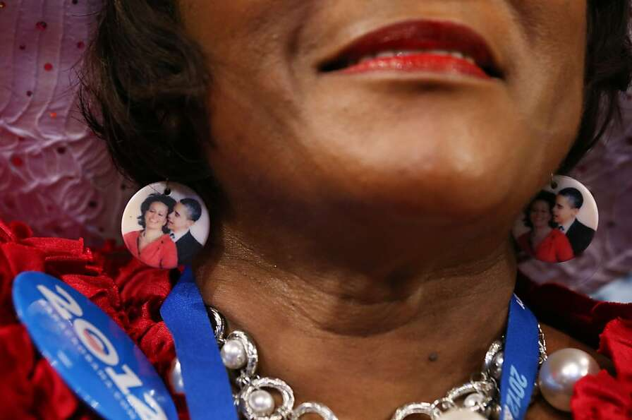 CHARLOTTE, NC - SEPTEMBER 04:  Delegate Gloria Goodwin wears earings depicting Democratic presidenti