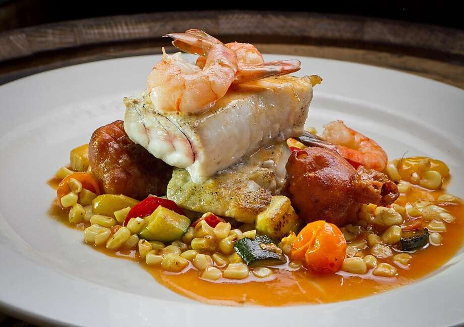 The seared local halibut at American Oak in Alameda includes shrimp, corn hush puppies and a vegetable ragout. Photo: John Storey