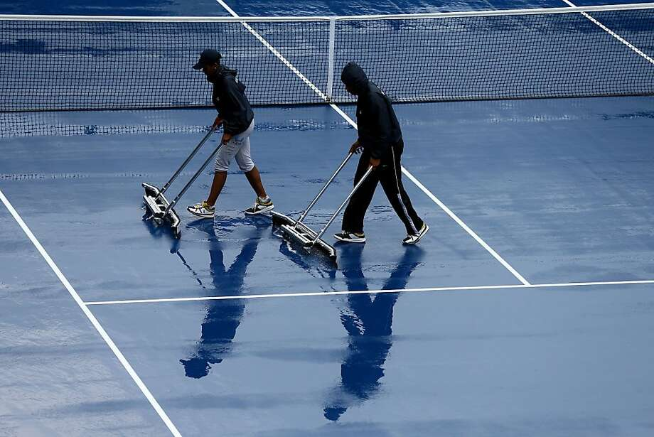 NEW YORK, NY - SEPTEMBER 04:  Grounds crew dry the court after rain suspened action during Day Nine of the 2012 US Open at USTA Billie Jean King National Tennis Center on September 4, 2012 in the Flushing neighborhood of the Queens borough of New York City.  (Photo by Al Bello/Getty Images) *** BESTPIX *** Photo: Al Bello, Getty Images