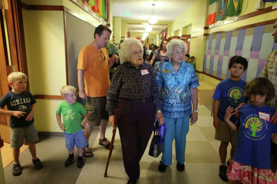 Betty Holm Odle, left, 87, and Ginny Murray, also 87, both graduates from McDonald in 1937, tour the newly remodeled building during the grand opening of the new McDonald International Elementary School in Seattle's Wallingford neighborhood on Tuesday, September 5, 2012. Parents, kids and community members came out to tour the new building and meet teachers before school starts on Wednesday. The new language immersion school will teach students in Japanese and Spanish. Photo: JOSHUA TRUJILLO / SEATTLEPI.COM
