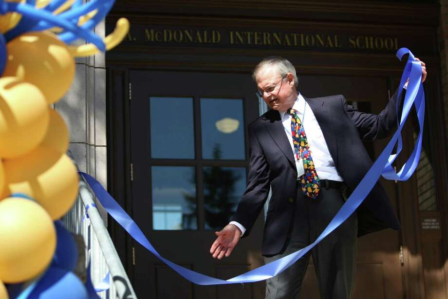 A ribbon is readied to be cut during the grand opening of the new McDonald International Elementary School in Seattle's Wallingford neighborhood. Photo: JOSHUA TRUJILLO / SEATTLEPI.COM