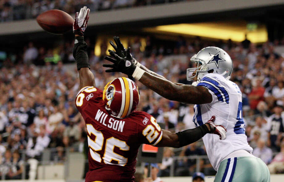 Washington Redskins Josh Wilson break up a pass intended for Dallas Cowboys Martellus Bennett at Cowboys Stadium in Arlington, Monday, Sept. 26, 2011. The Cowboys won with a late fourth quarter field goal, 18-16. Photo: JERRY LARA, San Antonio Express-News / SAN ANTONIO EXPRESS-NEWS