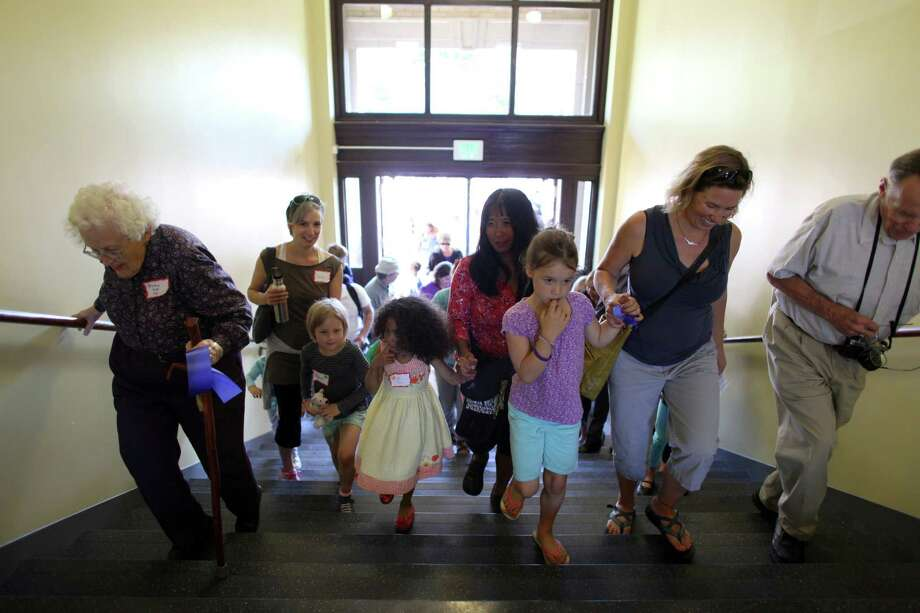 People enter the newly remodeled McDonald International Elementary School. Photo: JOSHUA TRUJILLO / SEATTLEPI.COM