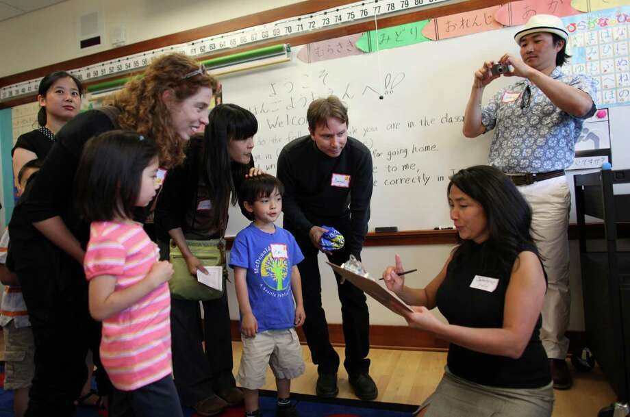 Japanese kindergarten teacher Michiko Olson meets her new students during the grand opening of the new McDonald International Elementary School. Photo: JOSHUA TRUJILLO / SEATTLEPI.COM