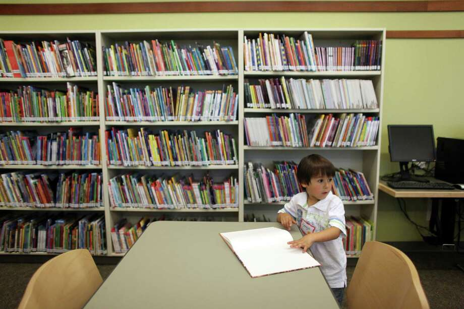 Django Koemans, who is starting kindergarten, checks out the library during the grand opening of the newly remodeled McDonald International Elementary School. Photo: JOSHUA TRUJILLO / SEATTLEPI.COM