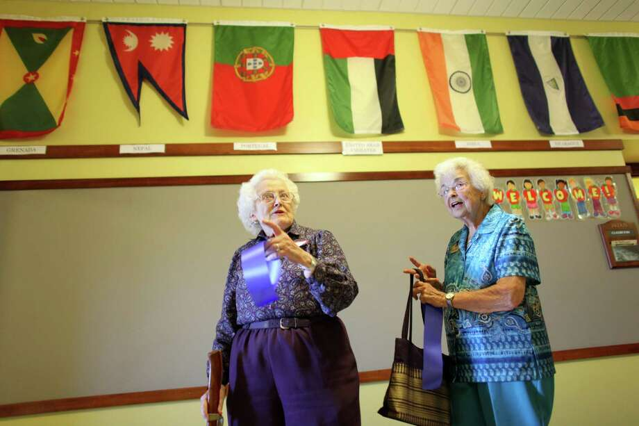 Betty Holm Odle, left, 87, and Ginny Murray, also 87, both graduates 