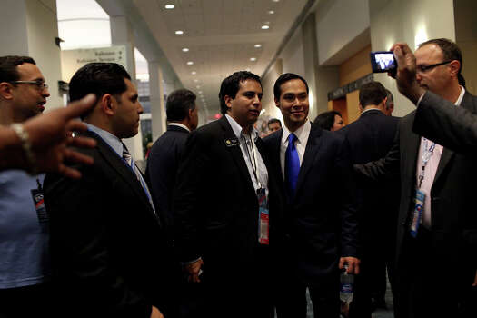 Mayor Julian Castro is inundated with people who want to congratulate him and have their picture taken with him as he makes the rounds at Latinos Unidos, a celebration of the Hispanic Caucus, delegates and voters, after he gave the keynote address at the Democratic National Convention in Charlotte, NC on Tuesday, Sept. 4, 2012. Photo: Lisa Krantz, San Antonio Express-News / San Antonio Express-News