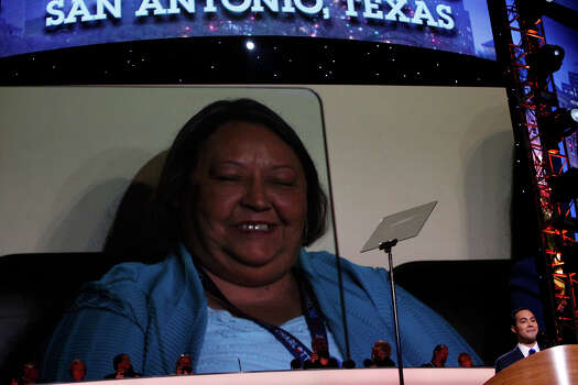 Rosie Castro, the mother of Mayor Julian Castro, is shown in her seat on the video screen behind him as he mentions her as he delivers the keynote address on the first night of the Democratic National Convention at Time Warner Cable Arena in Charlotte, NC on Tuesday, Sept. 4, 2012. Photo: Lisa Krantz, San Antonio Express-News / San Antonio Express-News