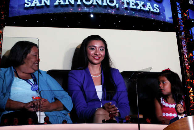 Rosie Castro, the mother of Mayor Julian Castro, his wife, Erica Castro and their daughter, Carina, 3, are shown in their seats on the video screen behind him as he gives the keynote address on the first night of the Democratic National Convention at Time Warner Cable Arena in Charlotte, NC on Tuesday, Sept. 4, 2012. Photo: Lisa Krantz, San Antonio Express-News / San Antonio Express-News