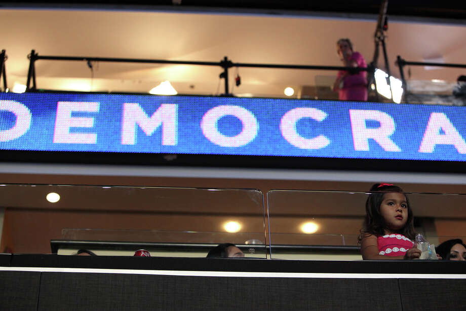 Carina Castro, 3, waits with her family for her father, Mayor Julian Castro, to deliver the keynote address on the first night of the Democratic National Convention at Time Warner Cable Arena in Charlotte, NC on Tuesday, Sept. 4, 2012. Photo: Lisa Krantz, San Antonio Express-News / San Antonio Express-News