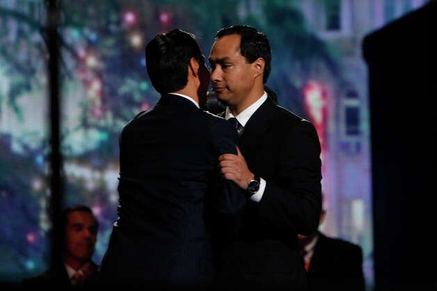 Mayor Julian Castro is embraced by his brother, Joaquin Castro, right, after he gave the keynote address on the first night of the Democratic National Convention at Time Warner Cable Arena in Charlotte, NC on Tuesday, Sept. 4, 2012. Photo: Lisa Krantz, San Antonio Express-News / San Antonio Express-News