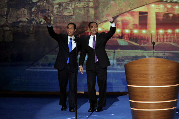 Mayor Julian Castro, left, joins his brother, Joaquin Castro, on stage after Joaquin introduced Julian to give the keynote address on the first night of the Democratic National Convention at Time Warner Cable Arena in Charlotte, NC on Tuesday, Sept. 4, 2012. Photo: Lisa Krantz, San Antonio Express-News / San Antonio Express-News