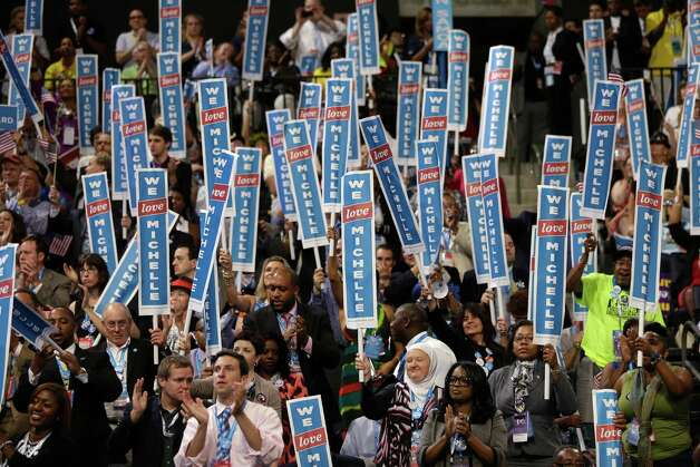 Delegates cheer as First Lady Michelle Obama addresses the Democratic National Convention in Charlotte, N.C., on Monday, Sept. 3, 2012. (AP Photo/Charles Dharapak) Photo: Charles Dharapak