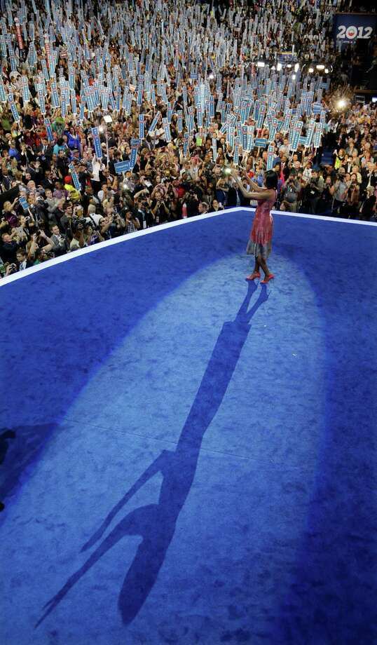 First lady Michelle Obama waves after speaking at the Democratic National Convention in Charlotte, N.C., on Tuesday, Sept. 4, 2012. (AP Photo/Charlie Neibergall) Photo: Charlie Neibergall, STF / AP