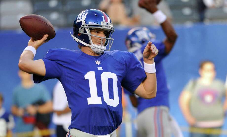 This Aug. 29, 2012 photo, New York Giants quarterback Eli Manning (10) warms up before a preseason NFL football game against the New England Patriots  in East Rutherford, N.J.  Manning is no longer living in the shadow of his big brother. The New York Giants quarterback enters the kickoff to the NFL season against the Dallas Cowboys on Wednesday night as a two-time Super Bowl MVP. He's now unquestionably among the league's elite after leading Tom Coughlin's team to two titles in five seasons, and a third title is a distinct possibility with the 31-year-old seemingly getting better coming off a career season. (AP Photo/Bill Kostroun) Photo: Bill Kostroun