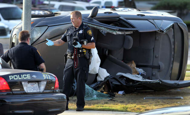 San Antonio police work Wednesday morning September 5, 2012 at the scene of a fatal traffic accident at the corner of Sigma and Sonterra. Detective Art Knox said a 19-year-old male was traveling east on the 700 block of Sonterra when he lost control of his Ford Focus shortly before 6:00 a.m. and struck a fire hydrant. Knox said the driver may have over corrected once having lost control of the vehicle. The man died at the scene. Photo: John Davenport, San Antonio Express-News / San Antonio Express-News