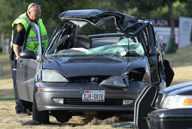 San Antonio police work Wednesday morning September 5, 2012 at the scene of a fatal traffic accident at the corner of Sigma and Sonterra. Detective Art Knox (not pictured) said a 19-year-old male was traveling east on the 700 block of Sonterra when he lost control of his Ford Focus shortly before 6:00 a.m. and struck a fire hydrant. Knox said the driver may have over corrected once having lost control of the vehicle. The man died at the scene. Photo: John Davenport, San Antonio Express-News / San Antonio Express-News