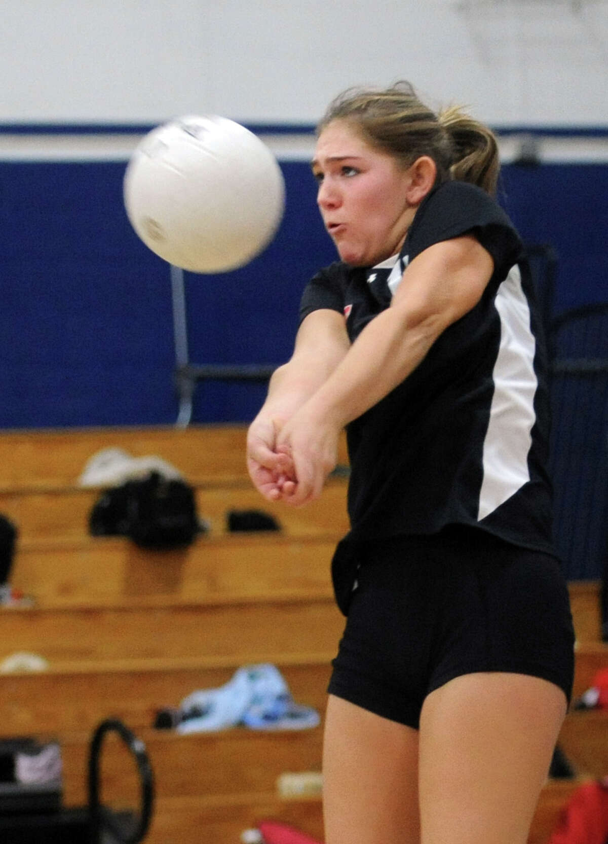 New Canaan's Emma Stracke returns the ball to Staples in the second round Class LL girls volleyball tournament Saturday, Nov. 12, 2011 at Staples High School.