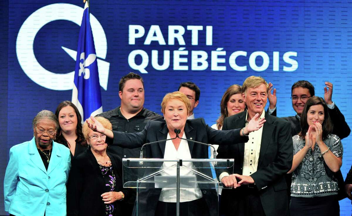 Parti Quebecois Leader Pauline Marois returns to complete her speech after being whisked off the stage by security in Montreal, Que., Sept. 4, 2012. With the win, Marois becomes the first female premier in Quebec history.