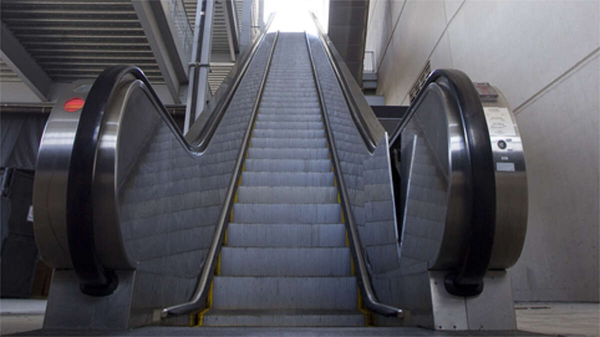 The escalator bank at the north east corner of Reliant Stadium is where a man fell from somewhere between the fifth and third level to his death, Aug. 31, 2012, in Houston. A man in in his 20's was reported to have falen to his death when he was siting on the rail of an escalator that descended from the fifth to third level during last night's Houston Texan's preseason game.