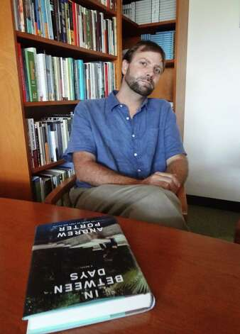 "Trinity University professor Andrew Porter's novel ""In Between Days"" chronicles the fragmentation and reformation of a Houston family. Photo: Photo By Steve Bennett"