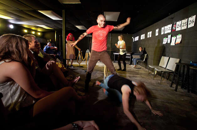 "At times fast and furious, action takes place almost in the laps of the audience as acting company Aesthetic of Waste performs ""We Stole This"" directed by Seth Larson, at The Overtime Theater, Friday, August 3, 2012. Photo: J. MICHAEL SHORT, FOR THE EXPRESS-NEWS / SAN ANTONIO EXPRESS-NEWS"