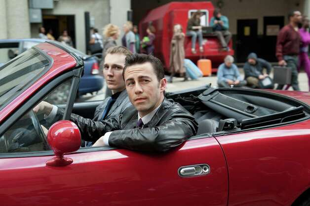 "This film image released by Sony Pictures shows Joseph Gordon-Levitt, foreground, and Paul Dano in a scene from the action thriller ""Looper."" (AP Photo/Sony Pictures Entertainment, Alan Markfield) Photo: Alan Markfield"