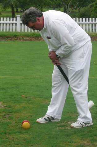 "Croquet buff Chris Fey, a radiologist at Greenwich Hospital, prepares to take a shot during a recent game against TV executive and good friend Chris Glowacki at the Greenwich Croquet Club court in Bruce Park. ""Each shot you make,"" says Fey, ""has a million pitfalls."" Photo: Anne W. Semmes"