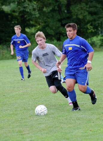 New Canaan High School boys soccer captain Marcus Hijkoop, at left, controls the ball during a scrimmage at the Saxe Middle School soccer field on Tuesday, Sept. 4, 2012. Photo: Amy Mortensen / Connecticut Post Freelance