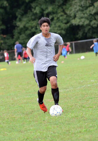 New Canaan High School boys soccer captain Justin Pertierra controls the ball during a scrimmage at the Saxe Middle School soccer field on Tuesday, Sept. 4, 2012. Photo: Amy Mortensen / Connecticut Post Freelance