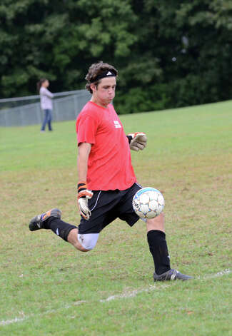 New Canaan High School boys soccer goalie Mike Powell puts the ball into play during a scrimmage at the Saxe Middle School soccer field on Tuesday, Sept. 4, 2012. Photo: Amy Mortensen / Connecticut Post Freelance