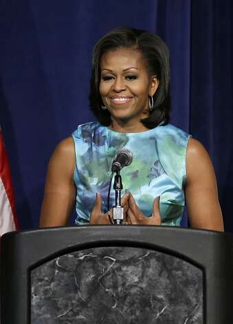 First lady Michelle Obama speaks during the African American Caucus Meeting at the 2012 Democratic National Convention, Wednesday, Sept. 5, 2012, in Charlotte, N.C. (AP Photo/Charlie Neibergall) Photo: Charlie Neibergall, Associated Press