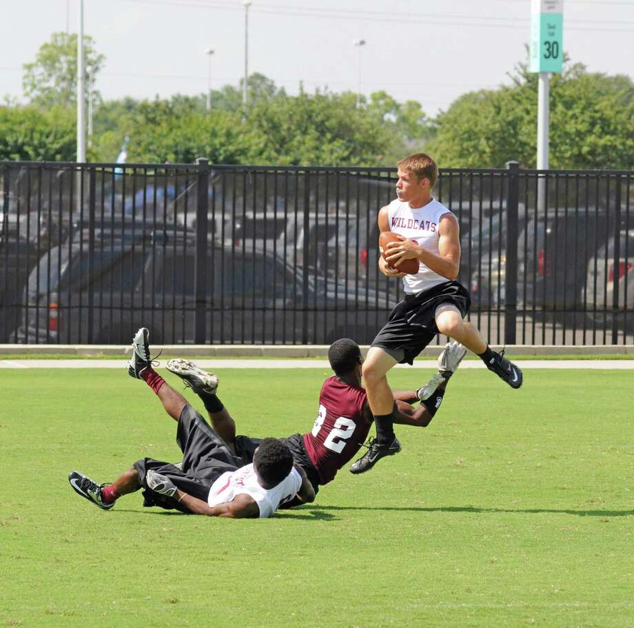 Clear Creek senior defensive back Tyler Jentzen (with ball) grabs an interception during the Houston Texans 7-on-7 State Qualifying Tournament on May 20, 2012. Also defending for Clear Creek is senior cornerback Marvis Nelson (on ground) during a pool play victory over Magnolia. The Wildcats placed second at the 7-on-7 event to qualify for state for the first time since 2003. Photo: L. Scott Hainline / The Chronicle