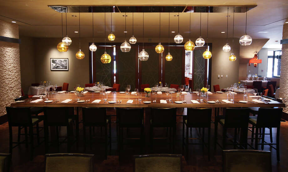 The communal table at Sustenio, located at Éilan Hotel Resort & Spa, offers an elegant dining experience with seating for up to 20 people. Photo: Jerry Lara, San Antonio Express-News / © 2012 San Antonio Express-News