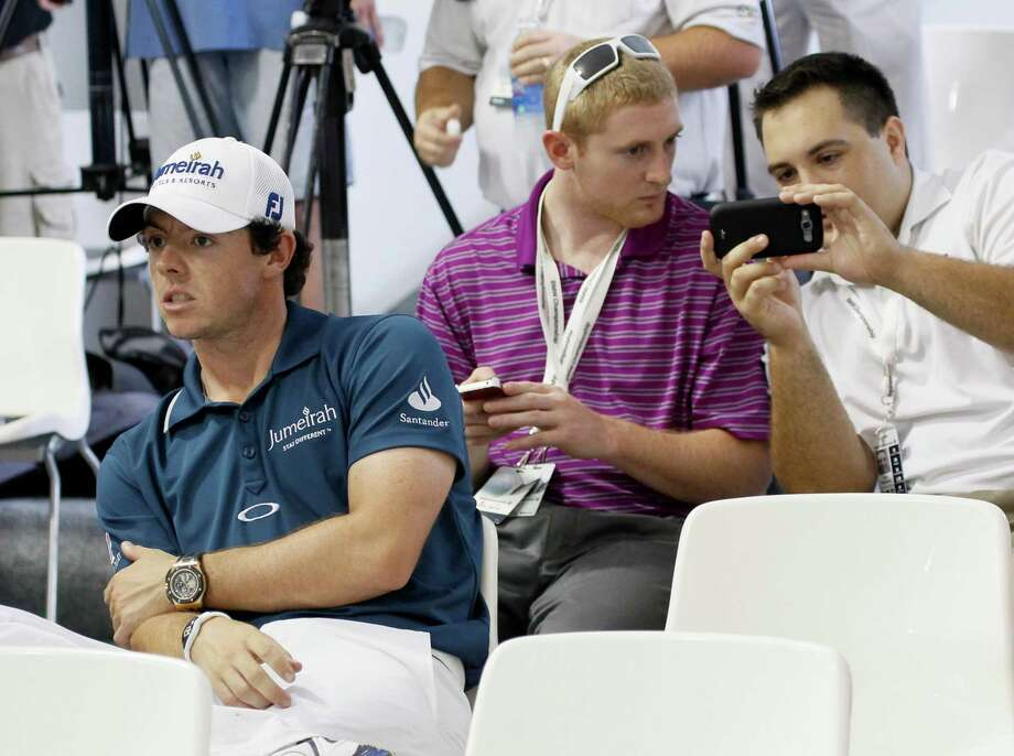 Rory McIlroy of Northern Ireland, left, listens to Tiger Woods at a news conference during the Pro-Am of the BMW Championship PGA golf tournament at Crooked Stick Golf Club in Carmel, Ind., Wednesday, Sept. 5, 2012. (AP Photo/Charles Rex Arbogast) Photo: Charles Rex Arbogast, Associated Press / AP