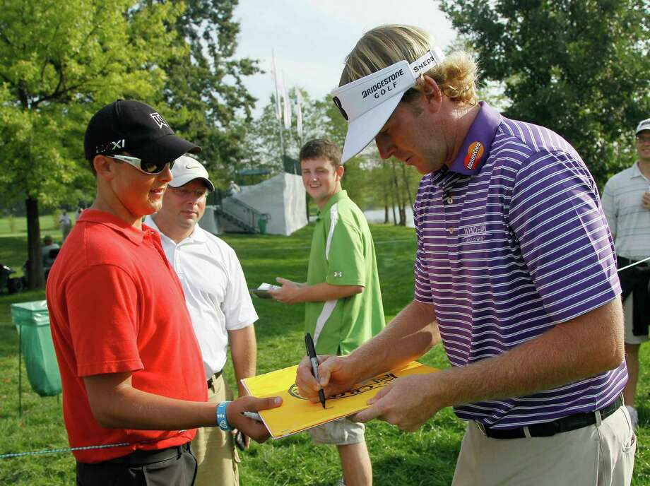 Brandt Snedeker signs an autograph on the ninth during the Pro-Am for the BMW Championship PGA golf tournament at Crooked Stick Golf Club in Carmel, Ind., Wednesday, Sept. 5, 2012. (AP Photo/Charles Rex Arbogast) Photo: Charles Rex Arbogast, Associated Press / AP
