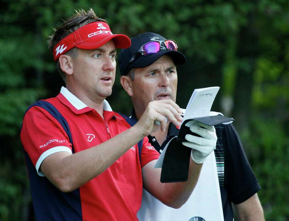 Ian Poulter of England, left, checks yardage with caddie Terry Mundy during the Pro-Am tournament of the BMW Championship PGA golf tournament at Crooked Stick Golf Club in Carmel, Ind., Wednesday, Sept. 5, 2012. (AP Photo/Charles Rex Arbogast) Photo: Charles Rex Arbogast, Associated Press / AP