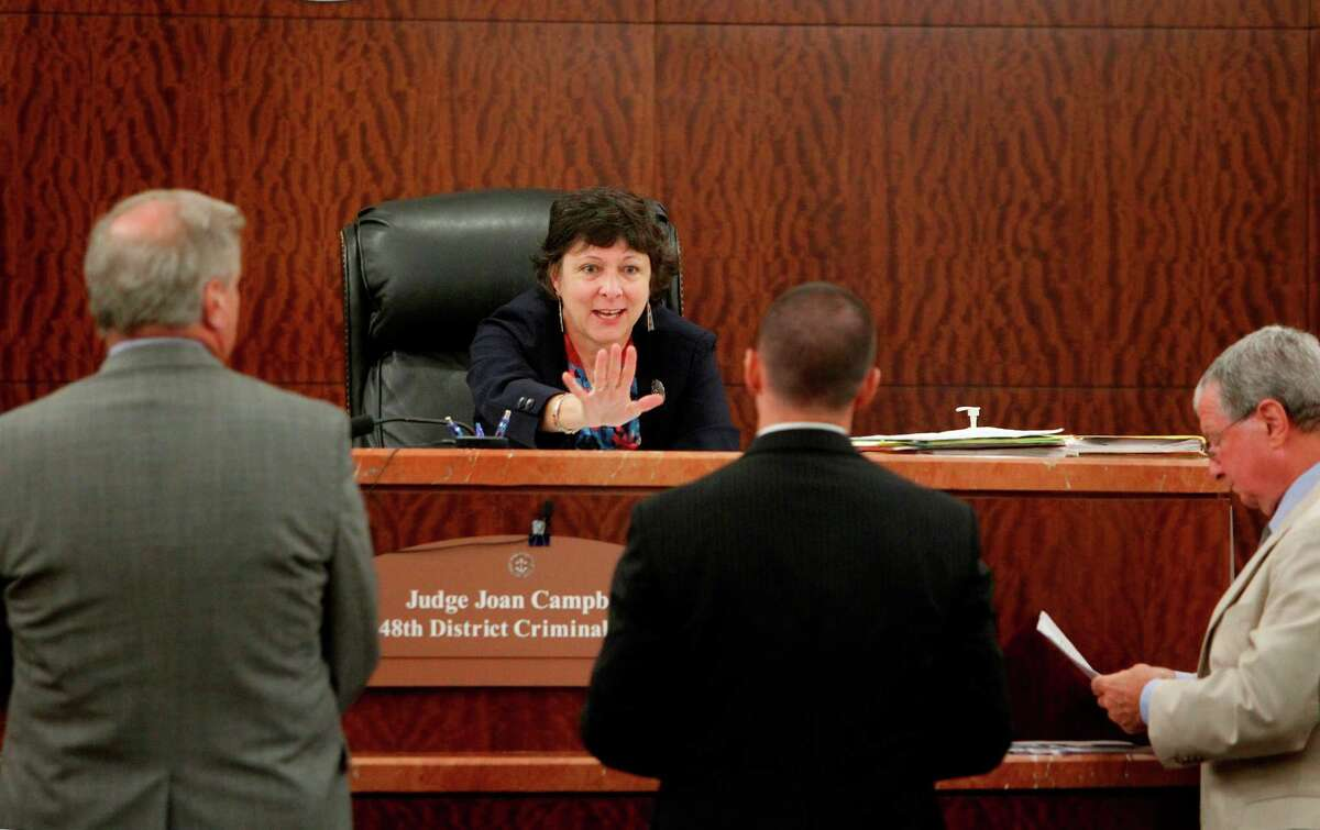 District Judge Joan Campbell addresses Joshua Phanco, Assistant Harris County District Attorney, as the judge hears the case of Austin police who infiltrated the protest group, and entrapped them into making devices they used in a blocking a road at the Port of Houston on Wednesday, Sept. 5, 2012, in Houston. Defense attorney for Ronnie Garza, of Occupy Austin who joined protest in Occupy Houston, will asked District Judge Joan Campbell to dismiss charges, saying trio of Austin undercover detectives showed them how to make